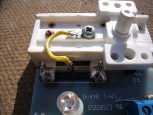 GB7WB Thermostat with yellow wire attached to new screw which provides new N/O contact