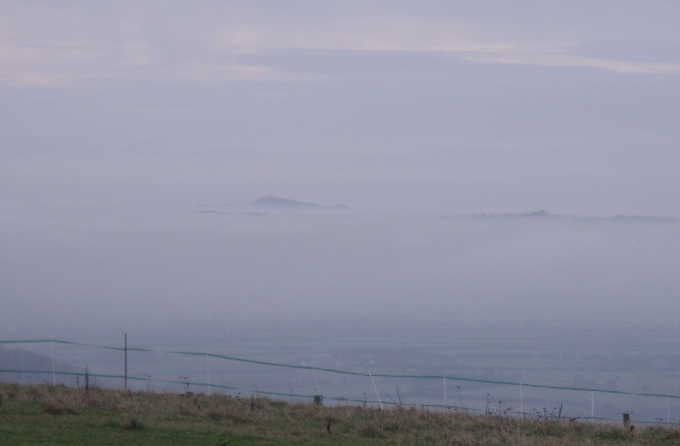 GB3WE View Of Glastonbury Tor Rising Through The Clouds